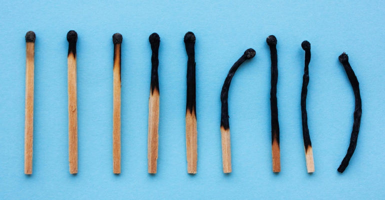 Burned matches in a row on a blue background.